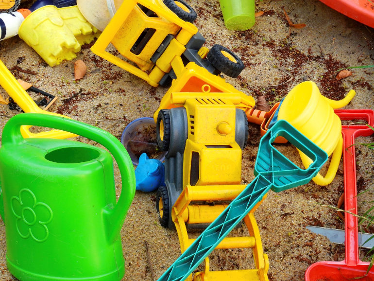 plastic toys in sand